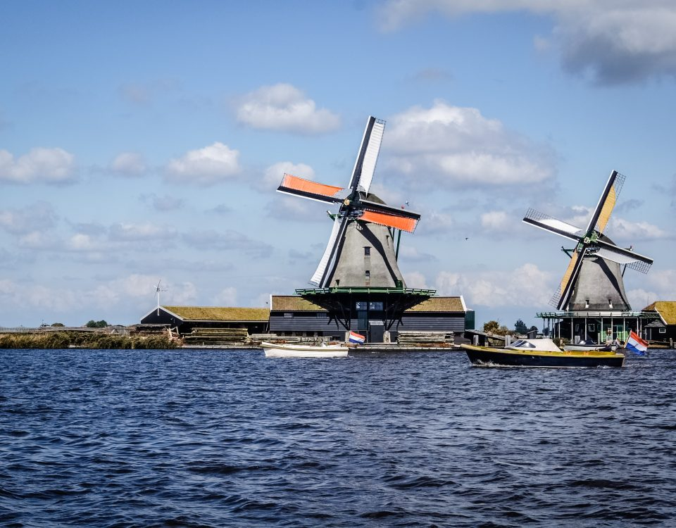 Beautiful lanscape of the Netherlands with windmills, boats and water