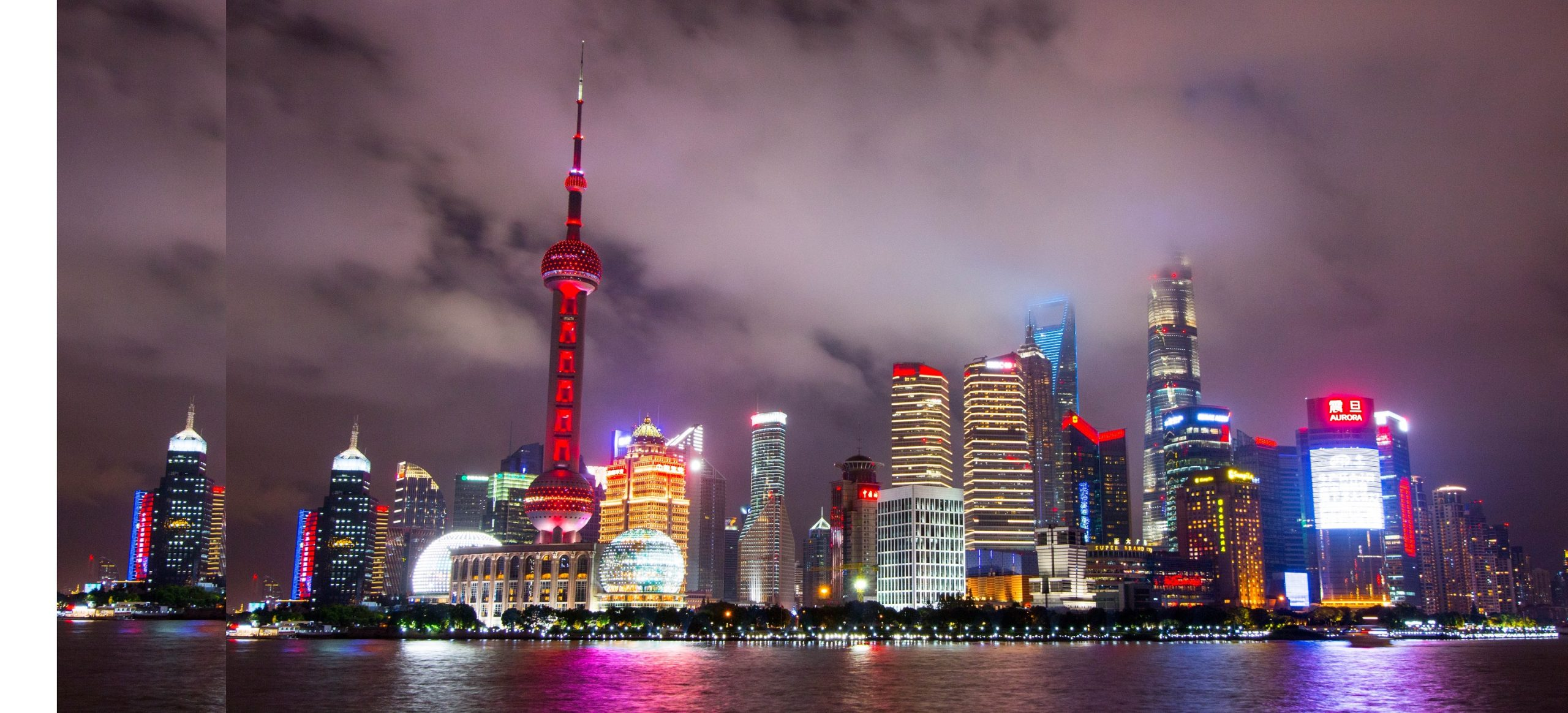 Shanghai the Bund skyline at night with lights and futuristic skyscrapers